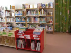 Rovaniemi Library. Children's area with well-designed tubs for picture books with front-facing slots on top and storage underneath.