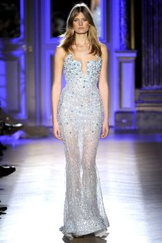 Zuhair Murad Spring 2012: The light blue color and sequins are beautiful! The silhouette is stunning. I like the sheer skirt.