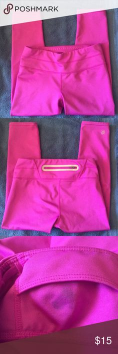 """Athleta Pink Capri Yoga Pants XS Excellent condition except for a small gum stain in the inside front mini pocket. Cannot be seen from outside - see picture. Priced accordingly. 12"""" across waist. 20"""" inseam. 7.5"""" rise. More of a purple/pink color as in picture 3. Athleta Pants Capris"""