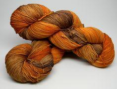 Pumpkin Spice Latte on Flamenco Monkey Superwash Merino Silk Cashmere blend fingering weight hand painted kettle dyed sock yarn orange brown by DyeMonkeyYarns on Etsy