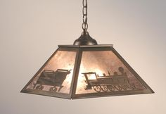 16 Inch Sq Train Pendant - 16 Inch Sq Train PendantA train takes a scenic ride along edge of thispendant. This picturesque fixture is finished in Antique Copper, has Silver mica panels, and is handcrafted in the USA by Meyda artisans. Theme: RUSTIC LODGE Product Family: Train Product Type: CEILING FIXTURE Product Application: PENDANT Color: ANTIQUE COPPER/SILVER MICA Bulb Type: MED. Bulb Quantity: 2 Bulb Wattage: 100 Product Dimensions: 12H x WPackage Dimensions: 17.500L x 17.500W x…