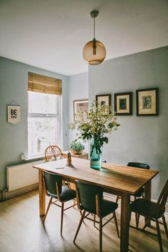 Love the mood; blown glass pendant, soft blue walls, homey and functional: SPACE: ANNA POTTER'S HOME.