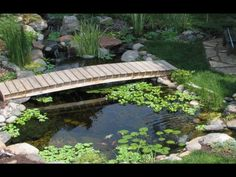 Pond King Water Gardens is an Aquascape Certified contractor. Water features are our specialty. We strive to bring the most natural and beautiful art to any landscape. We are a family owned company based out of MN. Pond Landscaping, Ponds Backyard, Koi Ponds, Pond Bridge, Garden Bridge, Garden Works, Diy Pond, Pond Waterfall, Garden Photos