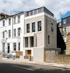 Liddicoat & Goldhill adds brick and concrete townhouse to the end of a London terrace