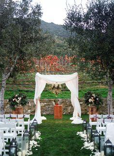 #chuppah, #green, #aisle, #outside  Photography: Erin Hearts Court - erinheartscourt.com Event Planning: Downey Street Events - downeystreetevents.com Ceremony Venue: Carmel Valley Ranch - www.carmelvalleyranch.com Wedding Dress: Jenny Packham - jennypackham.com  Read More: http://www.stylemepretty.com/2015/04/16/glamorous-carmel-valley-ballroom-wedding/