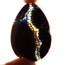 Unique black, blue Fire Agate pendant stone (EA187) by NaturalMineralsShop on Etsy https://www.etsy.com/listing/275020218/unique-black-blue-fire-agate-pendant
