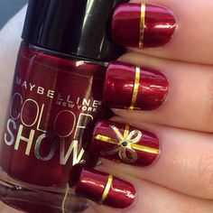 Red and Gold Bow Nail Design