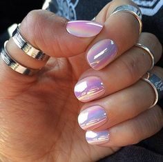 Reflective, white chrome nails.