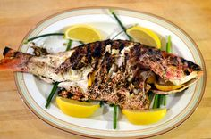 A recipe for grilled whole red snapper with lemon, garlic, and herbs.