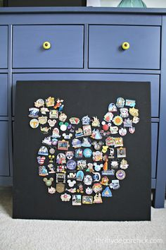 What do you do with all those pins your kiddos bring back from Disney World? Make Mickey Mouse Disney pin art!