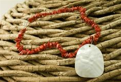 This is a powerful necklace from the sea!  A protection stone, Mother of Pearl brings gentle healing power of the sea.  It's a stress relieving stone; relaxing, soothing and calming.  It stimulates our intuition, imagination, sensitivity and adaptability.  Coral relates to the circulation of the blood and to the heart. It works against nutritional deficiencies, depression and lethargy.   Coral is also said to cure madness and give wisdom, & is used to build an emotional foundation.