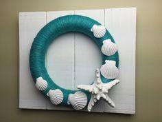 Coastal jute twine wreath on wooden fence.  https://www.facebook.com/insightsgallery/
