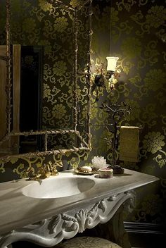 love the marble, gold and wallpaper for this bathroom!