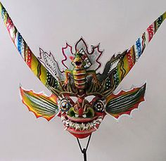 Carnival, Oruro, Bolivia.  The devil mask captures the essence of the Oruro Carnival. The devil or Supay represents the Andean pre-conquest underworld figure that was lord of the hills and transmogrified by the Christians as the Devil. Masks like this are worn with equally ornate costumes in the big parade.
