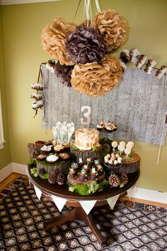 """Wow, that's a pretty puff ball """"chandelier""""! Woodland Birthday Party by Trophy's owner. Could be a cute baby shower theme too. Baby Birthday, 1st Birthday Parties, Birthday Ideas, Birthday Cake, Birthday Decorations, Baby Shower Decorations, Forest Party, Forest Theme, Forest Cake"""