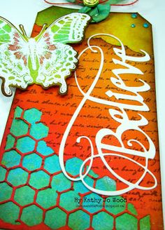 Scrapy Land Challenge- Tag and/or pockets using Elizabeth Craft Designs Believe die cut designed by Suzanne Cannon, Sizzix' Thinlits Mixed Media dies and Sizzix Butterfly Creativity stamp and die set. Dylusions sprays and Tim Holtz distress inks also used.