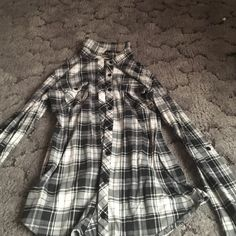 Plaid shirt Goes very well with black leggings and boots. Also can wear it tied around short during summer time. Passport Tops Button Down Shirts