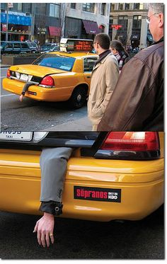 Arm sticking out of cab to promote sopranos tv show. So creative and simple. Relies on shock factor. People with then laugh when they see the sticker. Could be viral if made into a video with reactions from public. Attracts drama series lovers. Putting it in a widely seen object like the cab brings the surprise factor, it created a buzz which is what the brand wanted for the new series.