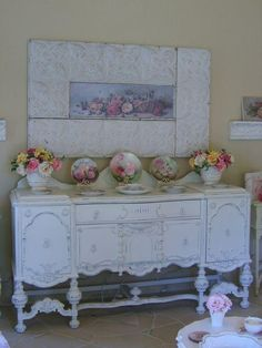 I love the tin frame and shabby roses...