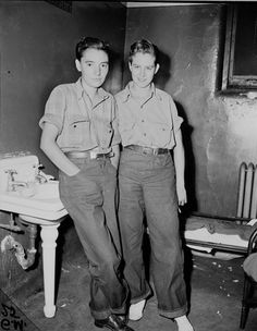 "Evelyn ""Jackie"" Bross (left) and Catherine Barscz (right) at the Racine Avenue Police Station, Chicago, June 5, 1943. In 1943 Evelyn ""Jackie"" Bross, was arrested on her way home from work for violating Chicago's cross-dressing and public indecency ordinance. Bross, 19yrs at the time, was a machinist at a WWII defense plant. Chicago outlawed cross-dressing as early as 1851"