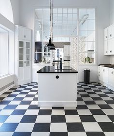 Kvänum kitchen & linoleum flooring with lovely glassed indoor wall.
