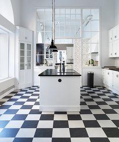 Kvänum kitchen & linoleum flooring with lovely glassed indoor wall.
