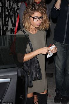 Stylish accessories: Sarah enhanced her understated look with a fringed leather handbag and clear lens spectacles