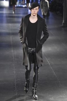 Saint Laurent... Those leather pants and boots tho... #Yes.