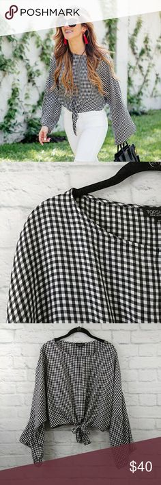 """Topshop Knot Gingham Top Black White Sz 10 Blogger favorite! Gingham Knot Top in a size 10 US fits a (10-12) Excellent Pre Worn No Flaws. Looks New!   Fabric is cotton, viscose blend   Measurements are below, taken straight across with the Garment laying flat  Length - 18"""" Topshop Tops"""
