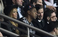 David Beckham talks to Jay Z while Beyonce watches on as PSG entertained Barcelona on Tues...