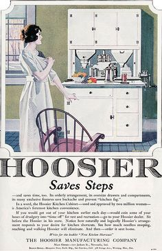 """Hoosier cabinet. It prevents """"kitchen fag."""" One of those spouts is a flour sifter, I think. Not sure what the other one is. I love the latches."""