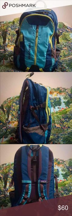 """Patagonia Backpack Refugio 28L Holds 15"""" Laptop Authentic Patagonia Backpack Refugio 28L holds 15""""Laptop  - Unisex • Deep ocean blue, teal & lime green  • Full size backpack with lots of compartments  Super nice...in Great, gently pre-owned condition  • Holds tons of stuff - features a 15"""" Laptop compartment. Keeps laptop or tablet safe.   Smoke free home   FAST SHIPPING BUNDLE AND SAVE Patagonia Bags Backpacks"""