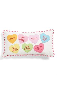This adorable pillow decorated in candy hearts would make a cute addition to the home for a festive vibe.