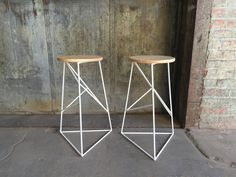 This unique stool is the perfect accent for the modern kitchen or bar. The welded steed frame explores random geometry. The seat is crafted from