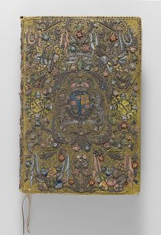 """Book cover Date: ca. 1624 Culture: British Medium: Satin worked with silk and metal thread. Dimensions: H. 13 1/4"""" x W. 9 1/4"""" x D. 3 3/8"""" (17.5 x 12.1 cm) Classification: Textiles-Embroidered"""