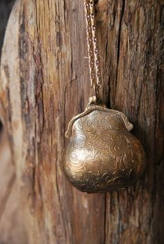 Silver Locket...I have one of these and it always makes me smile. It was an Estate Sale Find! Happy Day!