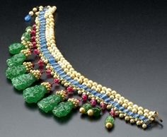 jewelry, France, Attributed to Maison Gripoix Chanel necklace, circa 1930. Pate de verre 'gems' and glass 'pearls' form a fringe collar in t...