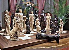Zeus, their ruler, plays the chess king while aphrodite, goddess of love, stands in as queen in this handcrafted set. Initially individually sculpted, each chess piece is then cast in bonded natural stone and polished to an enviable finish as part of an heirloom collection. King height: 6½. The deluxe wooden chess board (item im402) is finished by master wood craftsmen using intricate inlays finished with durable, heirloom-quality varnish for years of display and competition. 21sq. Key…