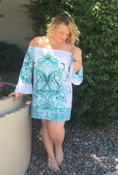Love Everything. FASHION MUST HAVE!!!!! We have expanded our Curvy Line to include this cute little number. Revel in warm breezes and blue skies while wearing an adorable tunic. The swirls of cream on teal and the off shoulder design make this a light hearted salute to the joys of summer.