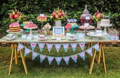 Mother's Day Afternoon Tea Party Dessert Table with Such Gorgeous Ideas via Kara's party ideas! full of decorating ideas, dessert, cake, cupcakes, favors and more! KarasPartyIdeas.com