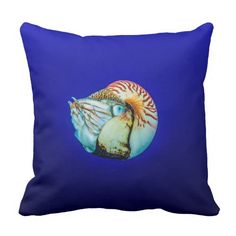 This throw pillow features a beautiful Nautilus shellfish in the clear blue waters of the Coral Sea on Australia's Great Barrier Reef.