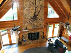 Rustic Stone fireplace between 2 windows