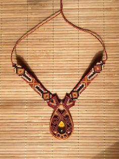 https://www.etsy.com/il-en/listing/535643772/macrame-necklace-amber-jewelry-gemstone?ref=shop_home_active_2