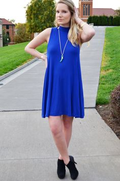 A high neck dress in the most beautiful royal blue color! A comfortable item that you can dress up or down. Easy to accessorize and wear with many types of jewelry, scarves, jackets, and shoes! Approx