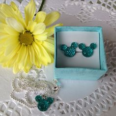 Taking new pictures of the Mouse Ears Collection jewelry sets.