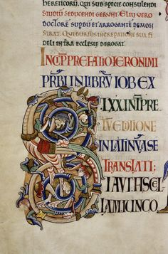 Colourful initial with - look carefully - a huge dragon that looks like a chicken (Bodleian MS. Auct. E. inf. 1).