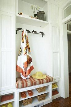 Cabinets, hooks and seating. What more could you want for an entry bench?
