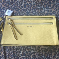 """Coach Yellow Clutch AUTHENTIC & NEW! Perfect for that pop of color for those fall outfits. 🍂 Beautiful soft pebbled leather. Pastel yellow w/ silver hardware. 2 separate zipper compartments. Fits all of your essentials. Length 12"""", height 7"""" & width 2"""". Feel free to ask any questions. All offers must be submitted through offer button only. Thank you for stopping by. 💕 Coach Bags Clutches & Wristlets"""