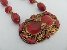 Detail of a vintage Art Deco Carnelian glass Czech necklace.