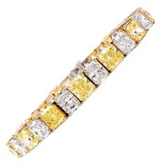 GIA Certified Natural Vivid and Fancy Yellow and White Diamond Bracelet | From a unique collection of vintage modern bracelets at https://www.1stdibs.com/jewelry/bracelets/modern-bracelets/